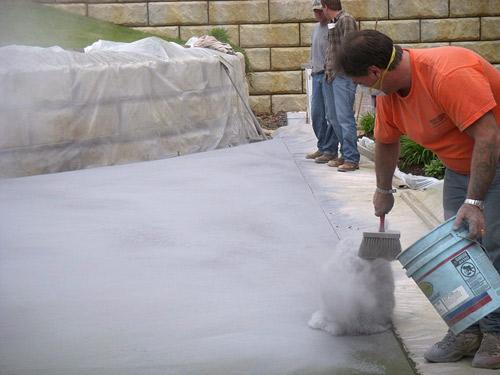Bart Sacco applies a dry-powder antique release agent prior to stamping. Photos courtesy of Concrete Kingdom Training Center