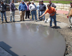 Bart Sacco applies a clear liquid release agent during a session at the Concrete Kingdom Training Center in Pennsylvania.