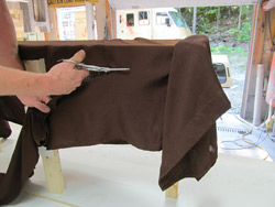 First, we will lay our fabric on the armature and cut it to the desired size and shape.