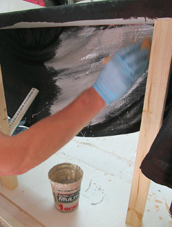 We applied one coat of the Bondo-resin mix on the exposed area of the inside of the mold.