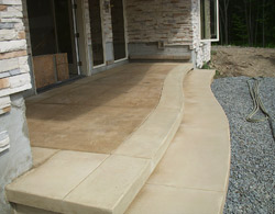 Color hardener was used to make this step border a lighter shade of color than the placed concrete.