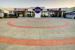 The entrance to NASA is stained with two red circles that lead to the main sign.