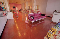 Brightly stained concrete floor in a salon.