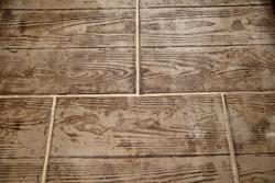 Woodplank like concrete overlay creates unique floor.