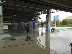 Ruben and his crew began the six-week project by grinding the concourse's patched areas and applying NewLook EcoAcid to open up the surface and expose the aggregate. They applied MiraPrime Universal using airless spray guns, followed by the Miracote RT, which they sprayed on using a high-performance spray gun from C.A. Technologies attached to a pressure pot that contained the material.