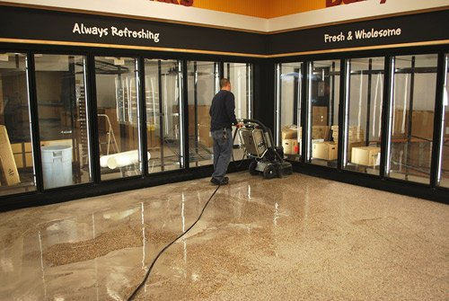 Nate Baggett of TW Cleaning Services Inc., one of a group of family-owned companies, uses a HTC 500 grinding machine with HTC terrazzo diamond tooling for a remodel job at a Wawa convenience store in Glen Burnie, Md. Photo courtesy of TW Cleaning Services Inc.
