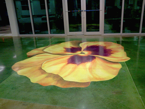 Creating a 10,000-square-foot canvas out of polished concrete to accommodate ginormous painted flowers was challenging for Donnie Sprecher.