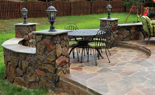 Stamped concrete backyard patio with individually colored concrete stone.