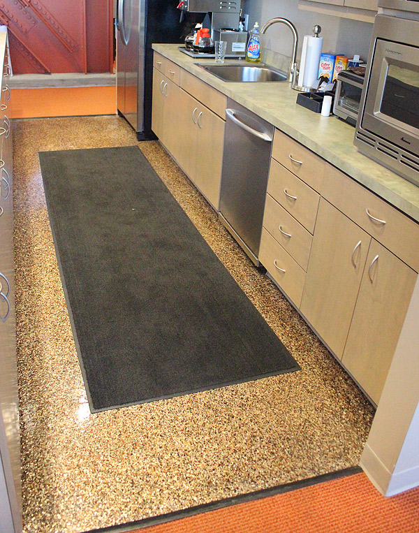 The coated kitchen floor at the corporate headquarters of Lamar Construction Co., based in Hudsonville, Mich., was decked out with Xtreme's V-8 Hybrid mica chip system. Photo courtesy of Xtreme Engineered Floor Systems
