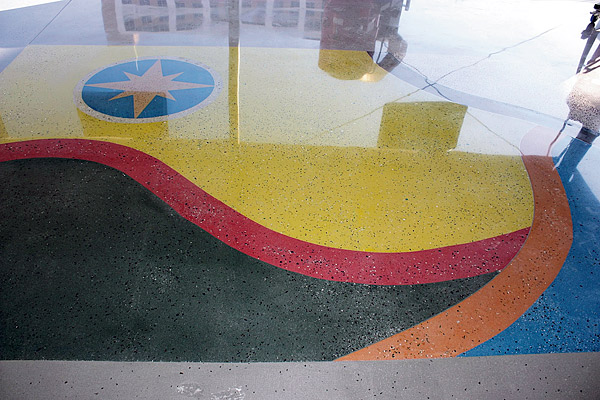 Glass aggregate was mixed integrally into this demo slab for a booth at the 2013 World of Concrete. Photo courtesy of Runyon Surface Prep Rental and Supply