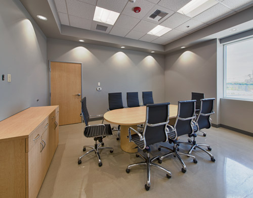 The conference room features Ardex PC-T Polished Concrete Topping.